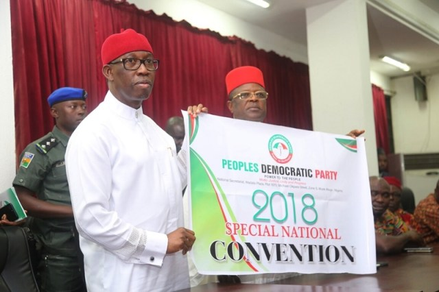Delta State Governor, Senator Ifeanyi Okowa (left) and Governor of Ebonyi State, Engr. Dave Umahi , displaying the 2018 PDP Special National Convention Flag, at Wadata Plaza, Abuja.