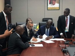 Sitting: Edo State Governor, Mr Godwin Obaseki (2nd right); and Mr Yang Hongtao of Peiyang Chemical Equipment Company of China (PCC) (2nd left); flanked by Nigerian officials at the signing of the investment agreement for the construction of a modular refinery in Benin City, in Beijing China.