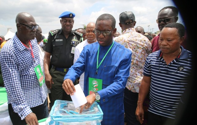 Delta State Governor, Senator Ifeanyi Okowa, casting his vote, with him is the State Peoples Democratic Party (PDP) Chairman, Barr. Kingsley Esiso (left), during the State PDP Governorship Primaries in Asaba.