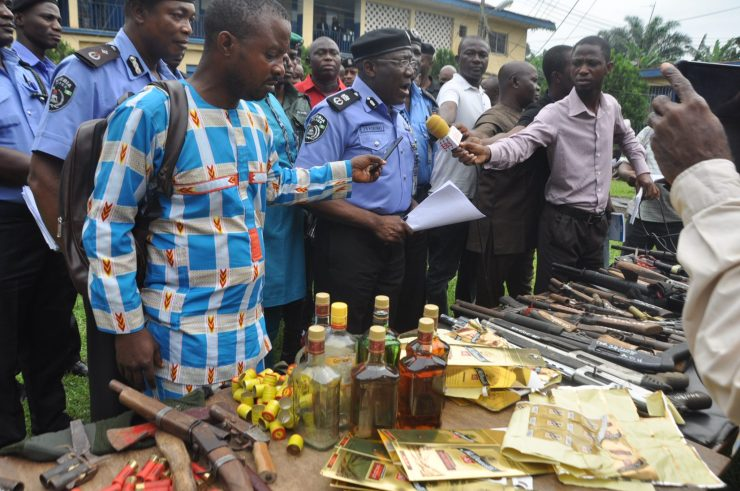 Edo State Commissioner of Police, Mr. Johnson Kokumo, parading 72 suspectedcultists, kidnappers, armed robbers in Benin City, Edo State