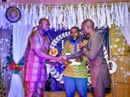 Chairman, Macaulay Media Vanguard, MMV, Mr Iteveh Ekpokpobe, (left) receiving the award on behalf of Comrade Ovuozourie Macaulay.
