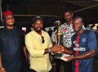Engr. Fidel Onwodi presenting the Football Trophy to the Winning Team