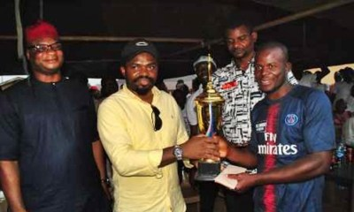 Engr. Fidel Onwodi presenting the Football Trophy to the Winning Team