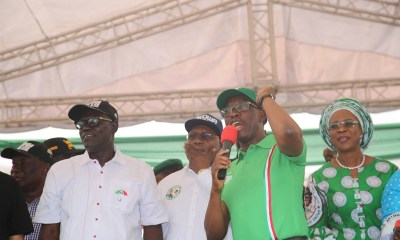 Delta State Governor Senator Ifeanyi Okowa (2nd right); his wife, Dame Edith (right); Delta State Deputy Governor, Barr. Kingsley Otuaro (2nd left) and State PDP Chairman, Barr. Kingsley Esiso , during Peoples Democratic Party (PDP) Campaign, Uvwie Local Government Area, Delta State.
