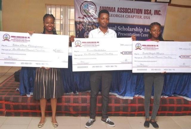 L-R: Miss. Chukwufumnanya Elikwu of Lagos State University, Mr. Otitodilichukwu Esennwa of University of Lagos and Miss. Maryann Obiageli Enebeli of University of Port Harcourt display their Prototype Cheques.