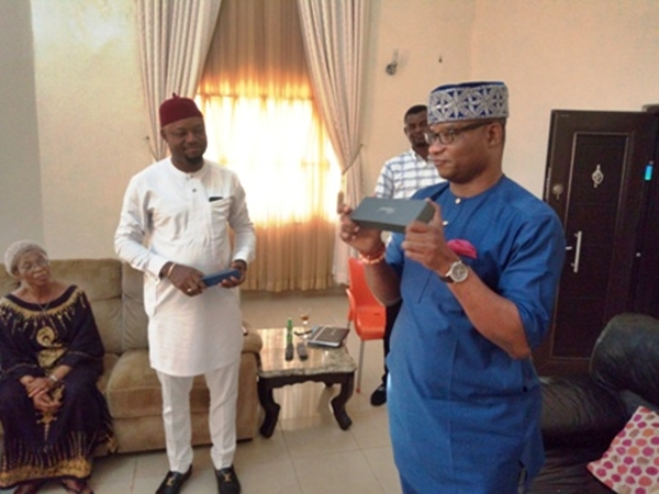 Chief Henry Nonso Ugbolue (right) Presenting the Symbolic Pen to Hon. Engr. Emeka Nwaobi (left)