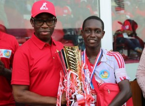 Delta State Governor, Senator Ifeanyi Okowa (left) presenting the Gold Trophy to the Team Captain of Obule Boys Integrated School, Neye Jolomi as the winner of 2018/2019 Edition of Zenith Bank Delta State Principals Cup Finals.