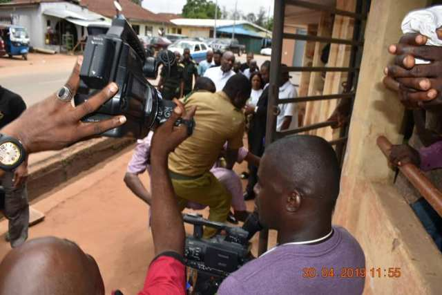 Ojokojo Robinson Obajero, the 63 years old ritual herbalist suspect in Elozino Murder case being carried into the court room