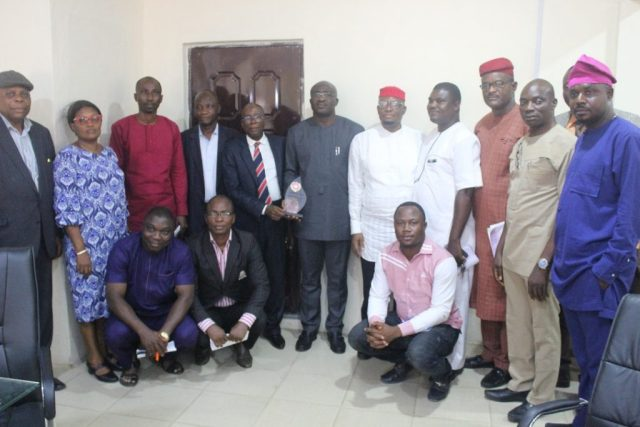 Chief Patrick Ukah flanked by the Leadership of Anioma Media Associates with Management and Staff of Ministry of Information after the Presentation of the Award