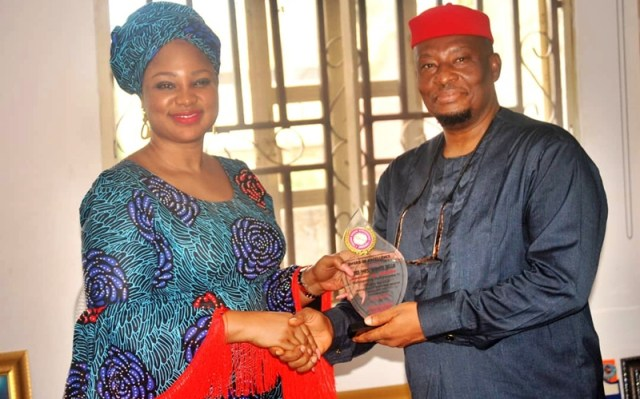 L-R: Chief Shimite Bello receiving Award from Anioma Media Associates being Presented by the National Coordinator, Prince David Diai