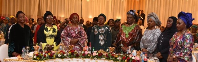 Wife of Edo State Governor, Mrs Betsy Obaseki (left); former deputy governor of Plateau State, Pauline Tallen (2nd left); wife of the vice president, Mrs. Dolapo Osinbajo (3rd left); Nigeria's First Lady, Aisha Buhari (4th left); and wife of Niger State Governor and President of Wives of Northern Governors' Forum, Dr Amina Sani Bello (2nd right), with other guests during a Dinner and Award Night organised by Aisha Buhari, for wives of the immediate past and incoming governors, in Abuja.