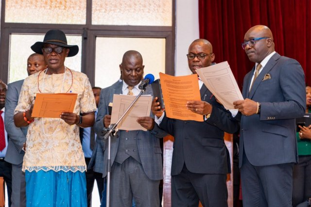 From right; Mr. Patrick Ukah; Mr. Chika Ossai; Chief Festus Ochonogor and Prof. Patrick Muboghare, Taking a Oath of Office as newly Appointed Commissioner in Delta State, held in Government House Asaba.
