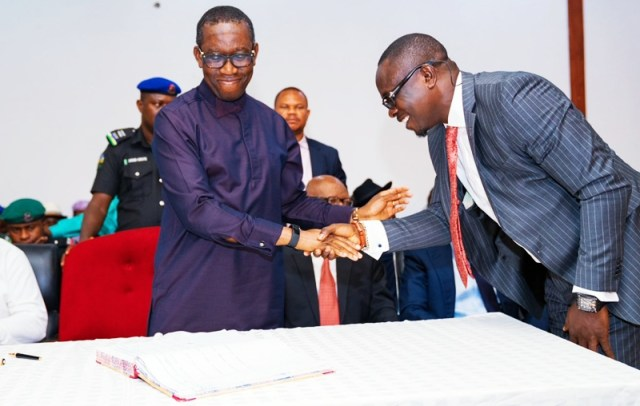 Delta state Governor, Senator Ifeanyi Okowa (left); congratulating Hon Efe Ofobruku, after been sworn-in as Special Adviser (Legislative Matters) to the Governor, in Government House Asaba, on July 2, 2019