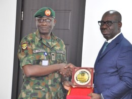 Edo State Governor, Mr. Godwin Obaseki (right) and General Officer Commanding, 2 Division, Nigerian Army; Major-General Anthony Bamidele Omozoje (left) during a courtesy visit to Governor Obaseki at the Government House, Benin City, the Edo State capital, on Wednesday, August 14, 2019.