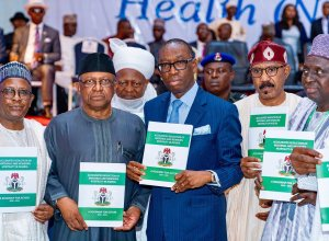 Delta State Governor, Senator Dr. Ifeanyi Okowa (center); Hon. Minister of Health Federal Republic of Nigeria, Dr. Osagie Ehanire (2nd left); Hon. Minister of State for Health, Dr. Olorunnimbe Mamora (2nd right), Others during the 62nd National Council on Health (NCH) Meeting, held at Dome Event Centre Okpanam Road, Asaba Delta State.