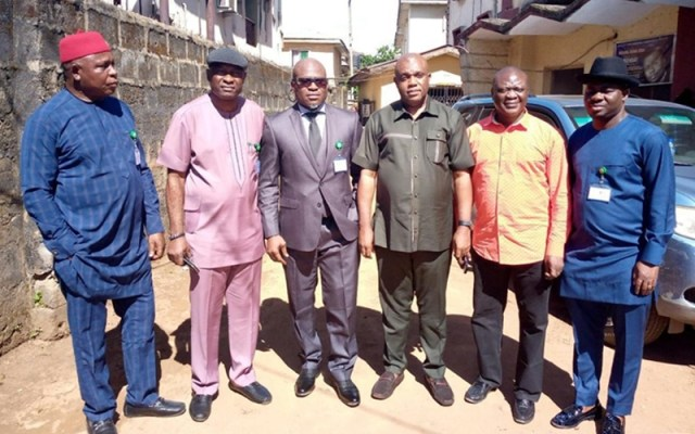Delta Commissioner for Lands flanked by Chairman and Members of Delta Assembly Lands Committee during a courtesy visit to the Ministry