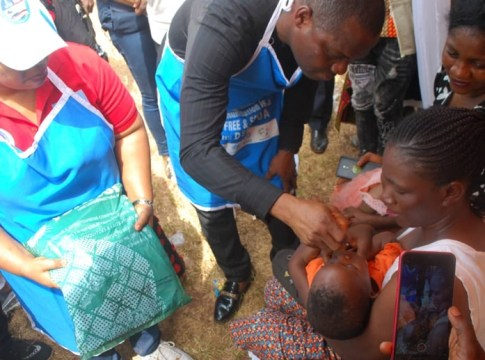 Representative of Delta Governor, Chika Ossai administering the Polio Vaccine to a Baby during the flag-Off of the Sub-National Immunization Plus Days in the State