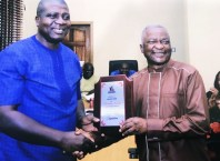 Mr Patrick Nkeki receiving special service and excellence award from Mr Ifeanyi Agbeyeke, a Member of the Delta State Civil Service Commission