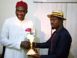Dr. Cairo Ojougboh (left) receiving the Distinguished Personality' Award, a New Face of NDDC, from the Jet Age Nation Builder Organization