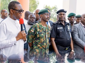 L-R: Delta Governor, Senator Ifeanyi Okowa, Brigade Commander 63 Brigade, Nigerian Army,Asaba, Brig. Gen. Ibrahim Jallo; the State Commissioner of Police, Mr Hafiz Mohammed Inuwa and the State Director of Department of State Security (DSS), Mr Ademola Adebiyi during the presentation of Patrol Vans to Security Agencies in Delta by the State Government