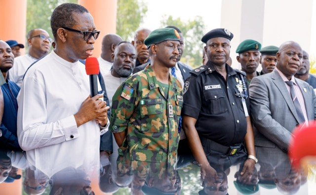 L-R: Delta Governor, Senator Ifeanyi Okowa, Brigade Commander 63 Brigade, Nigerian Army, Asaba, Brig. Gen. Ibrahim Jallo; the State Commissioner of Police, Mr Hafiz Mohammed Inuwa and the State Director of Department of State Security (DSS), Mr Ademola Adebiyi during the presentation of Patrol Vans to Security Agencies in Delta by the State Government