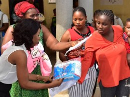Coordinator, Mercygate Foundation, Barr. Lilian Eserinune (left) distributing Sanitary Products to Nursing Mothers as part of the International Women's Day 2020 Celebration by the NGO