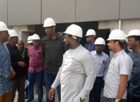 Executive Director of Projects, Dr. Cairo Ojougboh (middle) during the inspection of the NDDC Headquarters under construction