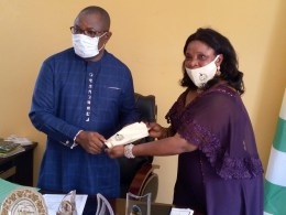 L-R: Mr. Benjamin Omotade, NYSC South-South Director and Mrs. Olutayo Samuel, NYSC Delta State Coordinator during a presentation of souvenir to mark the NYSC 47th Anniversary on Friday, May 22, 2020