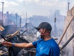 Governor Ifeanyi Okowa inspecting the burnt Ogbeogonogo market Asaba on Tuesday, May 26, 2020