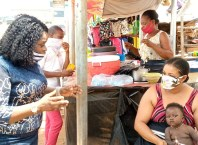 Mrs. Olutayo Samuel, Delta State Coordinator of NYSC leading Sensitization Campaign against Covid-19 in Delta Markets