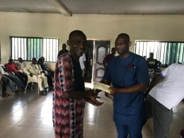 Delta Economic Planning Commissioner, Barry Pere Gbe (right) giving out Cash Sums to Bomadi Constituents