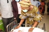 Wife of Delta Governor, Dame Edith Okowa with the 2021 first baby of the year delivered at the Asaba Specialist Hospital.
