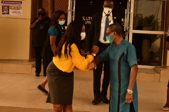 Mr. Reginald Bayoko, Delta State Head of Service (right) in COVID-19 greeting style with Dr. Isioma Okobah, Chairman, Delta State Primary Health Care Development Agency