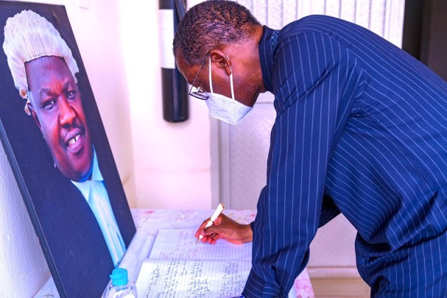 Delta Governor, Senator Dr. Ifeanyi Okowa Signing the Condolence Register during his condolence visit to the family of late Hon. Tim Owhefere at the Legislative Quarters, Asaba on Tuesday, February 9, 2021 (Pix: twitter.com/@iaokowa)