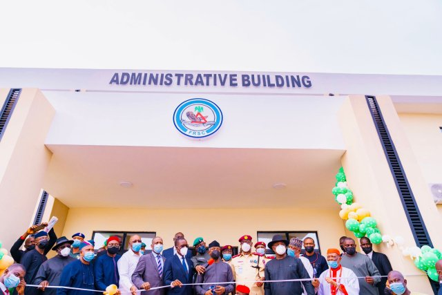 Vice President Yemi Osinbajo (middle) cutting the tape to inaugurate FRSC Marshal Inspectorate Training School, Owa-Alero, Delta State, built by Delta State Government flanked by Delta Governor, Senator Dr Ifeanyi Okowa (left); his Deputy, Mr Kingsley Otuaro; Minority Leader, House of Representatives, Rt .Hon Ndudi Elumelu; Chairman, FRSC Board, Mallam Bukhari Bello; Speaker, Delta State House of Assembly, Rt Hon Sheriff Oborevwori; Minister of State for Labour and Productivity, Festus Keyamo, SAN (right); Corps Marshal, FRSC, Boboye Oyeyemi and HRM, Dr Emmanuel Efeizomor II, Obi of Owa on Thursday, May 6, 2021