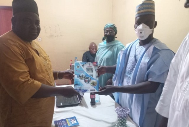 National Coordinator, Center for Peace and Environmental Justice, CEPEJ, Comrade Mulade Sheriff and President, Kano Civil Societies Forum, Ibrahim Wayya Exchanging Souvenirs.
