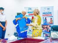 Dame Edith Okowa decorates Hajiya Aisha Gambo of Naval Officers' Wives Association (NOWA) with O5 INITIATIVE Uniform