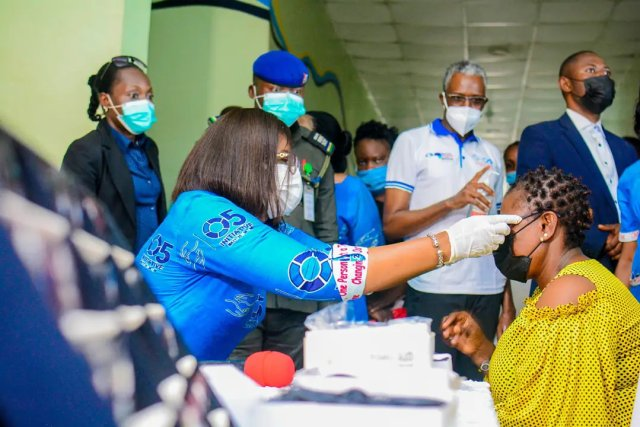Wife of Delta State Governor and Founder O5 Initiative, Dame Edith Okowa Presenting eye glasses to one of the beneficiary to flag of the second face of the O5 Initiative Free Medical Outreach at Eku Government Hospital, Eku, Ethiope East Local Government Area of Delta State on Wednesday, October 6, 2021