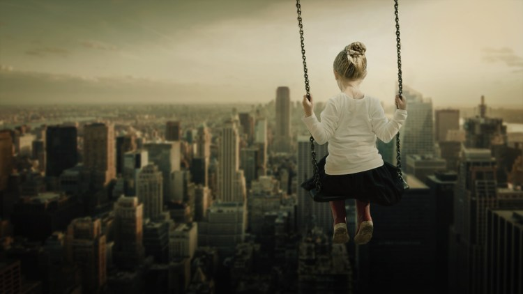 On a swing above the city