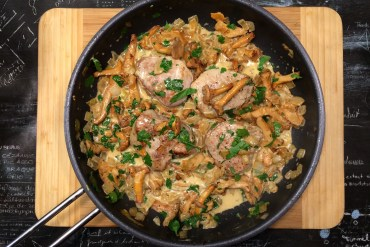 Pork fillet with a wild mushroom cream sauce in a pan