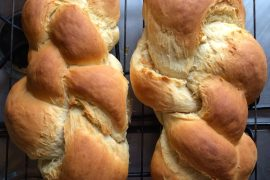 Two loaves of home-baked plaited German bread