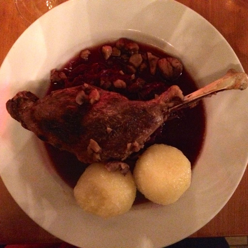 Roast goose leg with potato dumplings and braised red cabbage