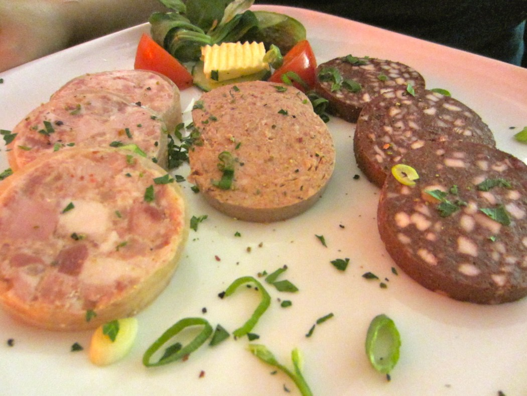 A plate of three different kinds of pre-cooked German sausages