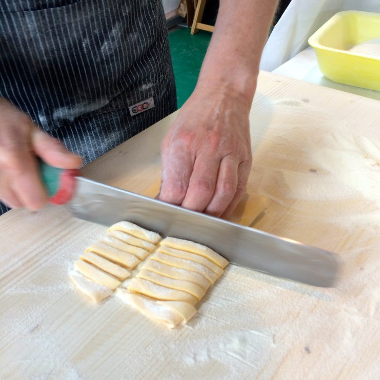 Fresh tagliatelle being made