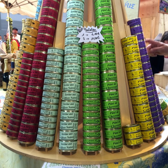 Colourful stack of tins of French patés