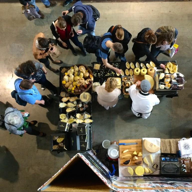 People tasting cheese at the Slow Food trade fair Stuttgart