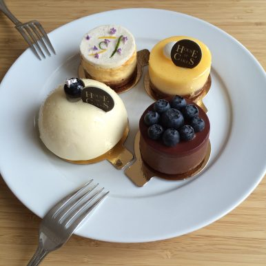 A plate of four petit fours from House of Cakes