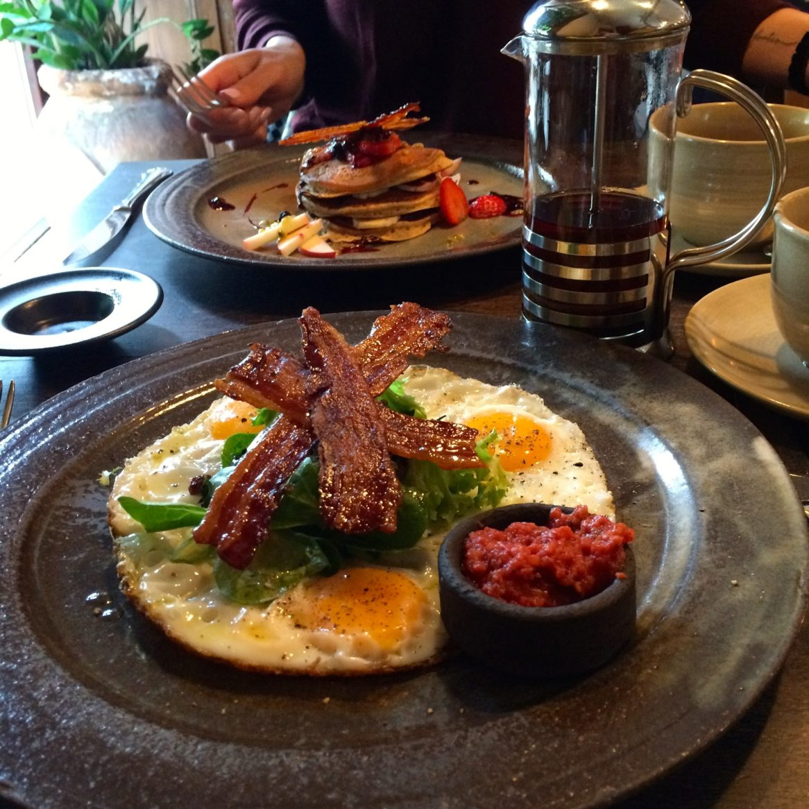 Plate of eggs and bacon at Sauvage
