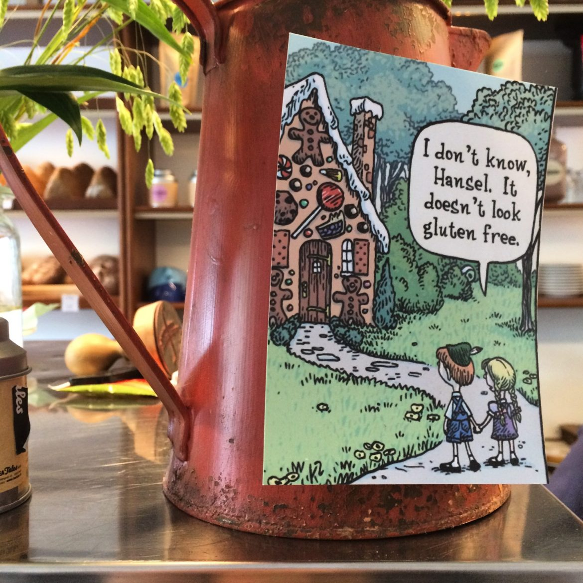 Postcard stuck to a copper jug