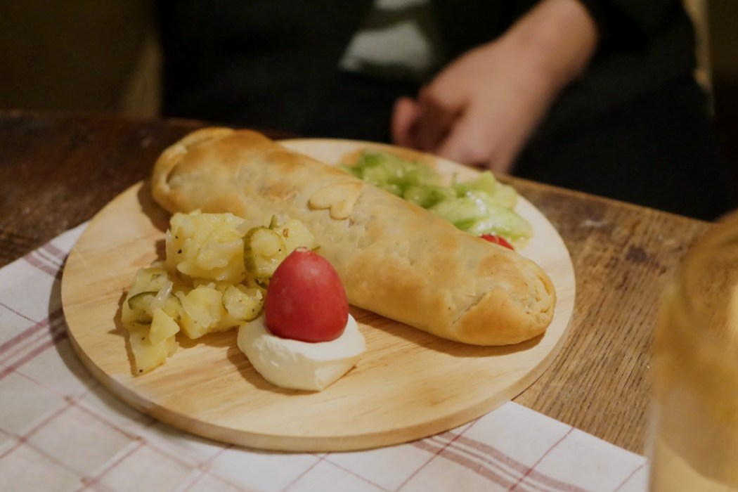 A vegetarian Strudel on a wooden board